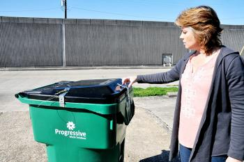 Catherine Siracusa St Mary Parish Black Bear Conflict Officer Demonstrates A Resistant Garbage Can Retroed With The Hardware Shown Below